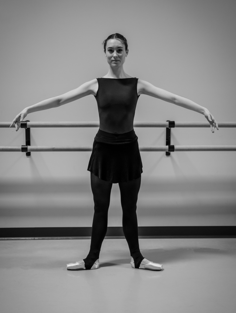 Second position. This pose mimics first position but places at least twelve inches of distance between the heels. The feet and legs should remain turned out.